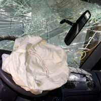 Deployed airbag and cracked windshield