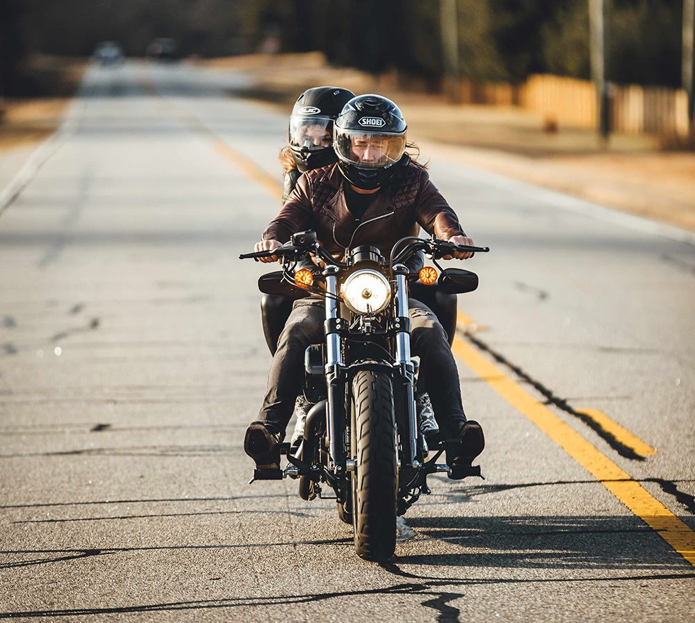 Couple riding on motorcycle
